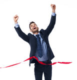 I won!. Businessman crossing the finish line Royalty Free Stock Photo