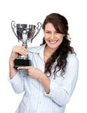 I won - Happy young female holding a trophy Stock Photo