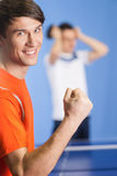 I won! Happy young table tennis player gesturing while his oppon Royalty Free Stock Photos