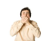 I won't tell you. Man covering his mouth with hands, white background Royalty Free Stock Photography