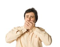 I won't tell you. Man covering his mouth with hands, white background Royalty Free Stock Images