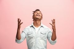 Winning success man happy ecstatic celebrating being a winner. Dynamic energetic image of male model. I won. Winning success happy afro man celebrating being a Royalty Free Stock Image