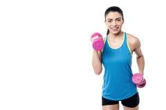 I am workout with dumbbells regularly. Stock Photo