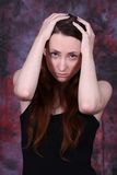 I am worry. Young woman in black dress and colored background Royalty Free Stock Photography