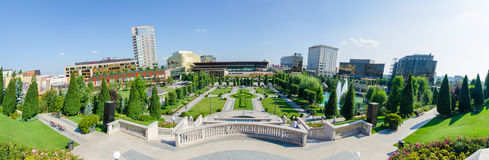 Iași Cultural Palace garden and Palas Mall. IASI. ROMANIA - 9 AUGUST 2014: Iasi Cultural Palace and Palas Mall Park with a beautifull fresh green look on a Royalty Free Stock Images
