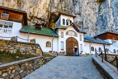 Ialomitei cave, Bucegi mountains, Saints Peter and Paul Church a. T the entrance. An orthodox Monastery built in a cave in Bucegi Mountains, Carpathians, Romania stock photo