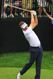 Ian Poulter pro golfer. Ian Poulter of Great Britain swings his driver club as the crowd watches above Royalty Free Stock Photo