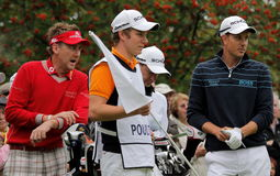 Ian Poulter talks to flight partner Henrik Stenson. Ian Poulter of England talks to Sweden's Henrik Stenson during a tournament Royalty Free Stock Photography