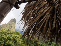 Iao needle against bungalow roof Royalty Free Stock Images