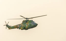 IAR Puma elicopter flying in the sky, stunt aerobatic. Stock Photography