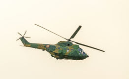 IAR Puma elicopter flying in the sky, stunt aerobatic Royalty Free Stock Photography