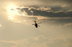 IAR Puma elicopter silhouette flying in the cloudy sky, stunt ae Royalty Free Stock Photo