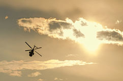 IAR Puma elicopter silhouette flying in the cloudy sky Royalty Free Stock Photos