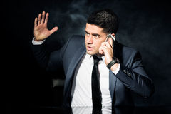 Iarte employer during business conversation. Photo of irate employer during phone business conversation Stock Image