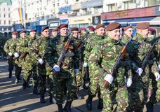 Soldiers in military green uniform marching and celebrating Royalty Free Stock Photos