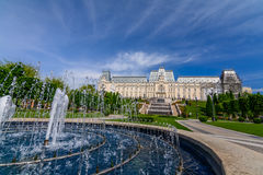 IASI, ROMANIA - 23 MAY 2015: Iasi Cultural Palace being restaurated with a beautiful green park on a sunny spring day with dramati. C sky on background Royalty Free Stock Photos