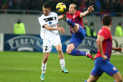 FC Steaua Bucharest- FC Gaz Metan Medias. Iasmin Latovlevici (R), Ciprian Petre (L) fighting for the ball, during the football match, counting for the Romanian Royalty Free Stock Photo