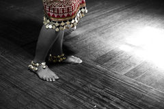 An Iban Girl's Story. The feet of an Iban girl in her traditional clothing. Traditions not passed down to the younger generations are eventually lost Stock Photo