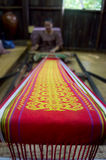 Iban people. KUCHING, SARAWAK, MALAYSIA - FEB 25: The ethnic Iban lady of Borneo weaving an exquisite decorative cloth in Kuching, Sarawak, on February 25, 2012 Royalty Free Stock Image