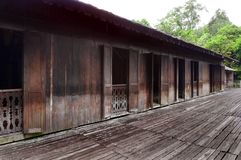 Iban tribe longhouse in Sarawak, Borneo. A photograph showing the beautiful and rustic architectural style of the Iban headhunters long house.  The Iban is a Stock Photo