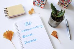 IBD Inflammatory Bowel Disease written in notebook. On white table Royalty Free Stock Images