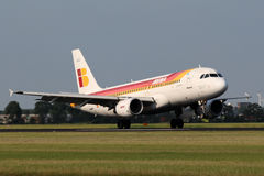 Iberia Airbus A320. AMSTERDAM - JULY 04: Iberia Airbus A320 lands at AMS Airport in Netherlands on July 04, 2012. Iberia is the flag carrier and largest airline Stock Photo
