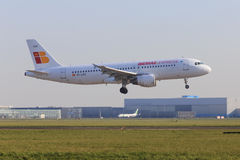 Iberia Express jet. Iberia Express Airbus A320 about to land at Schiphol Amsterdam Airport royalty free stock images