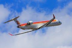 Iberia Regional aircraft taking off. An Iberia Regional (Air Nostrum) Canadair CRJ-900 is taking off Royalty Free Stock Photo