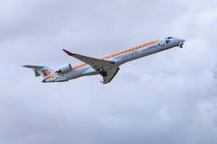 Iberia Regional aircraft taking off. An Iberia Regional Air Nostrum Canadair CRJ-900 is taking off Royalty Free Stock Photography