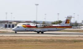 Iberia regional airliner landing in mallorca airport royalty free stock photos