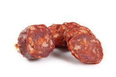 Iberian chorizo sliced. On white background Stock Image