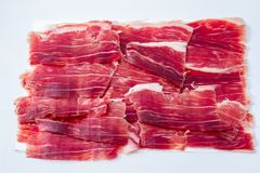 Iberian ham cut on white tray royalty free stock photography