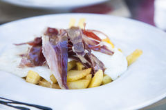 Iberian ham eggs and french fries Royalty Free Stock Photos