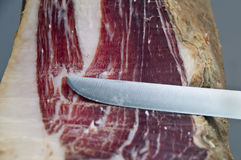 Iberian ham whith knife Stock Photography