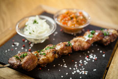 Iberian pork shish kebab Royalty Free Stock Image