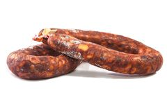 Iberian red spanish chorizos with their distinctive smokiness an. D deep red color. Isolated over white background Stock Photography