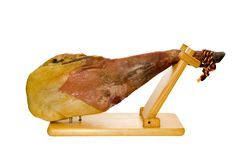 Iberian spanish ham on stand. Isolated on white background Stock Photography