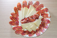 Iberian table. Ham, bacon and cheese slices royalty free stock photo