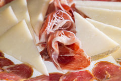 Iberian texture. Ham, bacon and cheese slices royalty free stock photo