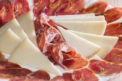 Iberian texture. Ham, bacon and cheese slices Stock Photos
