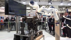 IBG presenting robot and human collaboration on Messe fair in Hannover, Germany. Hannover, Germany - April, 2018: IBG presenting robot and human collaboration on stock video footage