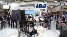 IBG presenting robot and human collaboration on Messe fair in Hannover, Germany. Hannover, Germany - April, 2018: IBG presenting robot and human collaboration on stock video