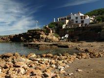 Ibiza beach landscape. Spanish beautiful villa on the beach stock photo