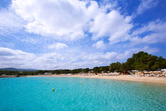 Ibiza Cala Bassa beach with turquoise Mediterranean. Sea at Balearic Islands Stock Photos
