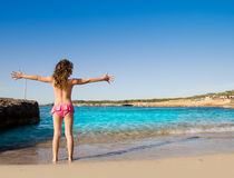 Ibiza Cala Conta beach open arms little girl Royalty Free Stock Photo