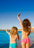 Ibiza Cala Conta little girls greeting hand sign. Ibiza Cala Conta beach little girls greeting hand sign saying bye Royalty Free Stock Photo