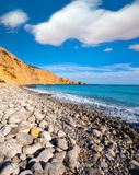 Ibiza Cala Jondal Beach with rolling stones in san Jose Royalty Free Stock Photo