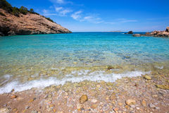 Ibiza Cala Moli beach with clear water in Balearics Stock Photos