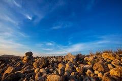 Ibiza Cap des Falco beach rolling stones in San Jose Stock Photo
