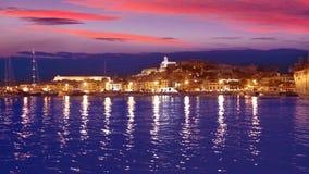 Ibiza Eivissa town sunset with city lights reflection in Mediterranean sea of balearic Islands